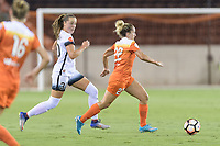 Houston, TX - Saturday July 08, 2017: Camille Levin brings the ball up the field with Celeste Boureille in pursuit during a regular season National Women's Soccer League (NWSL) match between the Houston Dash and the Portland Thorns FC at BBVA Compass Stadium.