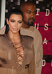 LOS ANGELES, CA - AUGUST 30: Rapper Kanye West and TV personality Kim Kardashian arrive at the 2015 MTV Video Music Awards at Microsoft Theater on August 30, 2015 in Los Angeles, California.
