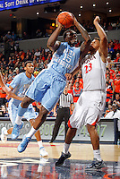 North Carolina guard P.J. Hairston (15) shoots the ball over Virginia guard Justin Anderson (23) during the game at the John Paul Jones arena in Charlottesville, Va. Photo/Andrew Shurtleff
