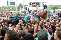 A man crowd surf during the Kiesza concert at the Festival d'ete de Quebec (Quebec City Summer Festival) Thursday July 9, 2015.