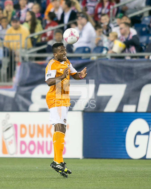 Houston Dynamo defender Jermaine Taylor (4) heads the ball.  The New England Revolution played to a 1-1 draw against the Houston Dynamo during a Major League Soccer (MLS) match at Gillette Stadium in Foxborough, MA on September 28, 2013.