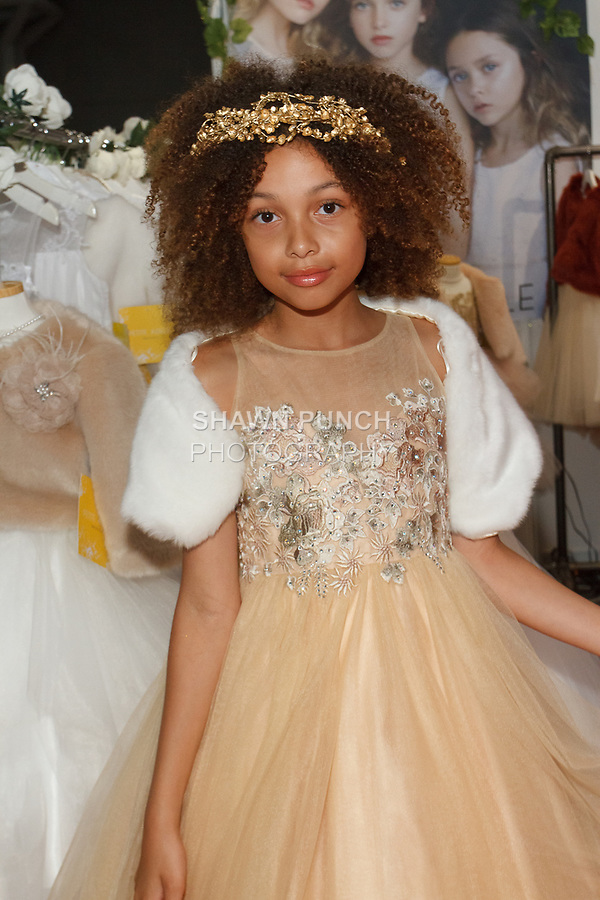 Model poses in an outfit from the Petite Adele collection by Sam Na, for the petitePARADE Spring Summer 2018 fashion show with Children's Club, at Javits Center in New York City, on August 7, 2017.