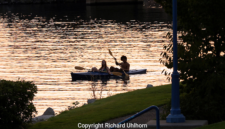 A couple paddle on the Chelan River at sunset
