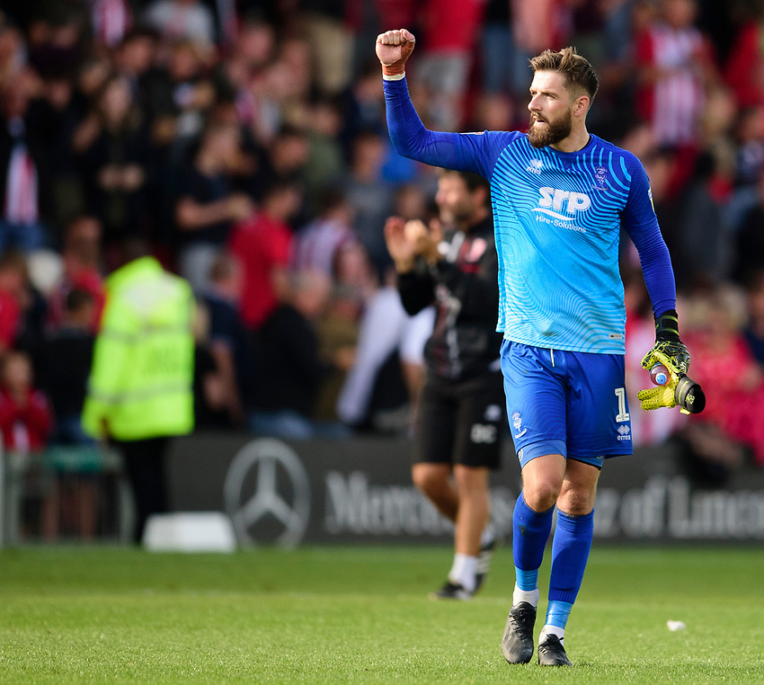 Lincoln City's Josh Vickers applauds the fans at the final whistle<br /> <br /> Photographer Andrew Vaughan/CameraSport<br /> <br /> The EFL Sky Bet League One - Lincoln City v Fleetwood Town - Saturday 31st August 2019 - Sincil Bank - Lincoln<br /> <br /> World Copyright © 2019 CameraSport. All rights reserved. 43 Linden Ave. Countesthorpe. Leicester. England. LE8 5PG - Tel: +44 (0) 116 277 4147 - admin@camerasport.com - www.camerasport.com