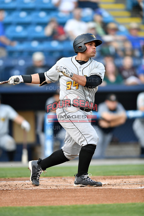 West Virginia Power designated hitter Carlos Munoz (34) swings at a pitch during a game against the Asheville Tourists at McCormick Field on May 10, 2017 in Asheville, North Carolina. The Tourists defeated the Power 4-3. (Tony Farlow/Four Seam Images)