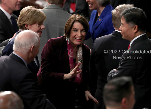 United States Senator Amy Klobuchar (Democrat of Minnesota) speaks with her colleagues prior to United States President Donald J. Trump delivering his second annual State of the Union Address to a joint session of the US Congress in the US Capitol in Washington, DC on Tuesday, February 5, 2019.<br /> Credit: Alex Edelman / CNP