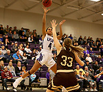 SIOUX FALLS, SD - NOVEMBER 25: Jasmine Harris #4 from the University of Sioux Falls takes the ball to the basket against Lauren Hedlund #33 from Southwest Minnesota State University during their game Saturday evening at the Stewart Center in Sioux Falls. (Photo by Dave Eggen/Inertia)