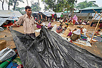 A Rohingya man who recently crossed the border from Myanmar takes down his temporary shelter as he finishes registration in the Kutupalong Refugee Camp near Cox's Bazar, Bangladesh. More than 600,000 Rohingya refugees have fled government-sanctioned violence in Myanmar for safety in this and other camps in Bangladesh.