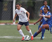Sky Blue FC forward Lisa De Vanna (11) dribbles as Boston Breakers midfielder Mariah Noguiera (20) pressures. In a National Women's Soccer League Elite (NWSL) match, Sky Blue FC (white) defeated the Boston Breakers (blue), 3-2, at Dilboy Stadium on June 16, 2013.