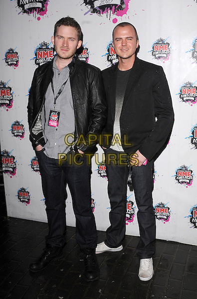 MATT LITTLER & DARREN JEFFRIES.The Shockwaves NME Awards 2010 held at Brixton Academy, London, England..February 24th, 2010.full length black leather grey gray shirt  jacket jeans denim .CAP/BEL.©Tom Belcher/Capital Pictures.