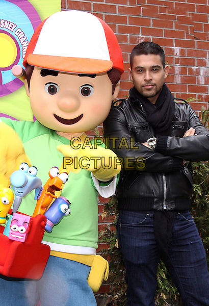 "WILMER VALDERRAMA.Star of Disney Channel's Hit Multicultural Series ""Handy Manny"" helps New York City Kids plant a Community Garden for Earth Day, New York, NY, USA, .15th April 2009..half length black leather jacket scarf jeans kids tv show character tools children's .CAP/ADM/PZ.©Paul Zimmerman/Admedia/Capital Pictures"