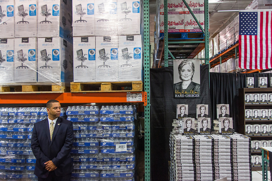 Security watches as former Secretary of State Hillary Clinton attends a signing her new book, 'Hard Choices: A Memoir,' at Cosco in Arlington, VA.  Clinton is on a nationwide tour to promote the new memoir with a book signings, speeches & media interviews.