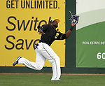 SIOUX FALLS, SD - AUGUST 2:  Reggie Abercrombie #1 from the Sioux Falls Canaries makes a diving catch against the Kansas City T-Bones Friday night at the Sioux Falls Stadium. (Photo by Dave Eggen/Inertia)