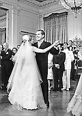 Washington, DC - June 12, 1971 -- United States President Richard M. Nixon dances with his daughter, Tricia Nixon Cox at the reception in the East Room of the White House in Washington, D.C. on Saturday, June 12, 1971 following the Rose Garden wedding.  More than 400 guests and family attended the happy affair..Credit: Pool via CNP