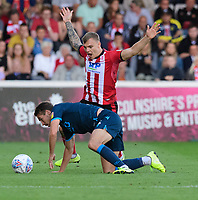 Lincoln City's Harry Anderson vies for possession with Bristol Rovers' Luke Leahy<br /> <br /> Photographer Chris Vaughan/CameraSport<br /> <br /> The EFL Sky Bet League One - Lincoln City v Bristol Rovers - Saturday 14th September 2019 - Sincil Bank - Lincoln<br /> <br /> World Copyright © 2019 CameraSport. All rights reserved. 43 Linden Ave. Countesthorpe. Leicester. England. LE8 5PG - Tel: +44 (0) 116 277 4147 - admin@camerasport.com - www.camerasport.com
