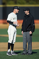 Wake Forest Demon Deacons head coach Tom Walter (16) discusses a call at second base with umpire Thomas Newsom during the game against the \rd\ at David F. Couch Ballpark on March 6, 2016 in Winston-Salem, North Carolina.  The Demon Deacons defeated the Spiders 17-4.  (Brian Westerholt/Four Seam Images)