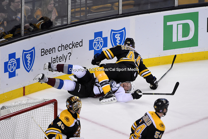 Thursday, November 12, 2015: Boston Bruins defenseman Dennis Seidenberg (44) lands on Colorado Avalanche right wing Jack Skille (8) during the National Hockey League game between the Colorado Avalanche and the Boston Bruins held at TD Garden, in Boston, Massachusetts. Colorado defeats Boston 3-2 in regulation time. Eric Canha/CSM