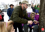PLYMOUTH CT. 08 March 2014-030814SV03-Jerry Milne of the Plymouth Land Trust taps a Maple tree during a demonstration on how to get sap for syrup at The Plymouth Maple Festival in Plymouth Saturday. <br /> Steven Valenti Republican-American