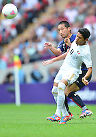 August 07, 2012..Mexico's Javier Aquino is defended by Japan's Yuhei Tokunaga during Semi Final match at the Wembley Stadium on day eleven in Wembley, England. Mexico defeat Japan 3-1 to reach Men's Finals of the 2012 London Olympics...