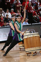 STANFORD, CA - FEBRUARY 1:  Members of the Stanford Taiko student group perform during Stanford's 68-51 win over the UCLA Bruins on February 1, 2009 at Maples Pavilion in Stanford, California.