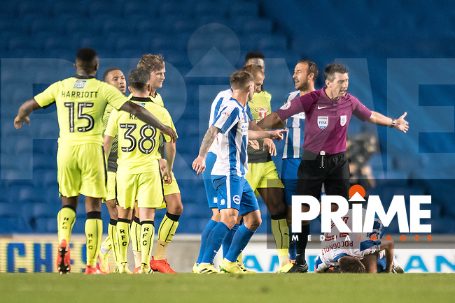 Bad foul on Sebastien Pocognoli of Brighton & Hove Albion (12) and a red card shown for Tyler Blackett of Reading FC   during the EFL Cup 3rd Round match between Brighton and Hove Albion and Reading at the American Express Community Stadium, Brighton and Hove, England on 20 September 2016. Photo by Edward Thomas.