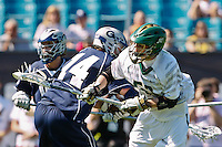 February 20, 2011:   Jacksonville Dolphins midfielder Jeremy Tissenbaum (53) fights off Georgetown Hoyas defender Chris Nourse (14) during Lacrosse action between the Georgetown Hoyas and Jacksonville Dolphins during the Moe's Southwest SunShine Classic played at EverBank Field in Jacksonville, Florida.  Georgetown defeated Jacksonville 14-11.