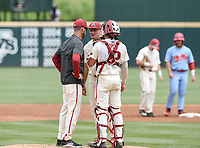 NWA Democrat-Gazette/CHARLIE KAIJO A pitching staff member talks to Arkansas Razorbacks Kole Ramage (28)  during game two of the College Baseball Super Regional, Sunday, June 9, 2019 at Baum-Walker Stadium in Fayetteville. Ole Miss forces a game three with a 13-5 win over the Razorbacks