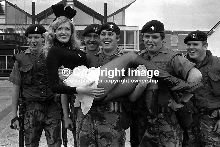 Bunny girl Theresa Lewis, 22 years, from the London Playboy Club, is welcomed by soldiers from the Royal Regiment of Wales currently serving in N Ireland. Theresa is the regimental pin-up and she paid a flying visit to them on 5th July 1974. 197407050379c..Copyright Image from Victor Patterson, 54 Dorchester Park, Belfast, United Kingdom, UK...For my Terms and Conditions of Use go to http://www.victorpatterson.com/Victor_Patterson/Terms_%26_Conditions.html