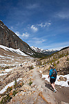A hiker walks along the trail near Mount Edith Cavell, in Jasper National Park, Alberta, Canada.  Photo by Gus Curtis.