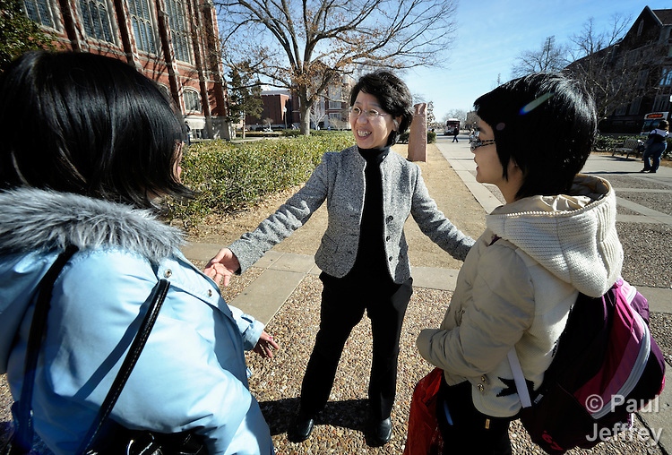 The Rev. Fuxia Wang is a United Methodist missionary, serving as a church and community worker on the staff of the Wesley Center at the University of Oklahoma in Norman, where she works with international students. Here she talks with Yong Yao Zhoug (left) and Chunchun Zhu, both Chinese students.