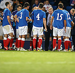 Rangers manager Ally McCoist gives a team talk to his players on the park ahead of the 30 minutes of extra time