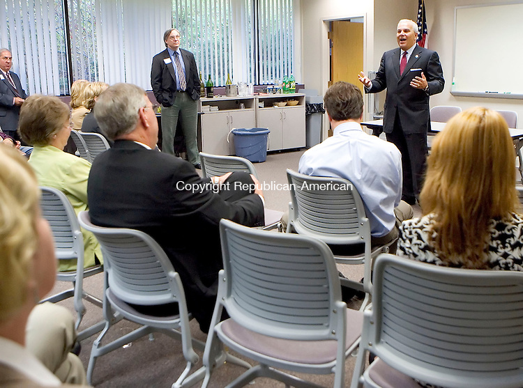 TORRINGTON, CT- 03 OCT 2007- 100307JT08- <br /> At right, Lt. Gov. Michael Fedele addresses a group of attendants of a meet &amp; greet event at Northwest Connecticut's Chamber of Commerce office in Torrington on Wednesday. The event was sponsored by West State Mechanical, Inc. and ConnectiCare.<br /> Josalee Thrift / Republican-American