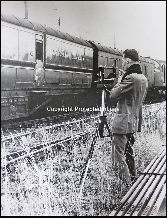 BNPS.co.uk (01202 558833)<br /> Pic: Ben Cavanna/DWA/BNPS<br /> <br /> DC John Bailey at the scene in 1963.<br /> <br /> A unique step by step record of the Great Train Robbery compiled by the first detective on the scene has come to light, 50 years after the 'Crime of the century'.<br /> <br /> DC John Bailey's meticulous scrapbook's give a fascinating blow by blow picture account of the notorious heist from the scene to the capture and trial of the nine robbers.<br /> <br /> Dominic Winter auctions in Cirencester are selling the historic books with a &pound;3000 estimate.