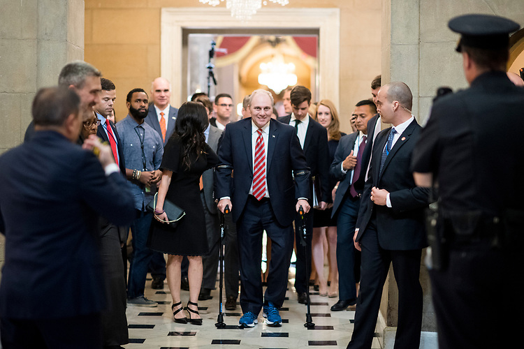 UNITED STATES - SEPTEMBER 28: House Majority Whip Steve Scalise, R-La., walks with his wife Jennifer from the House chamber to his office in the Capitol on his first day back in Congress on Thursday, Sept. 28, 2017. Scalise was shot during baseball practice for the Congressional Baseball Game in June. (Photo By Bill Clark/CQ Roll Call)