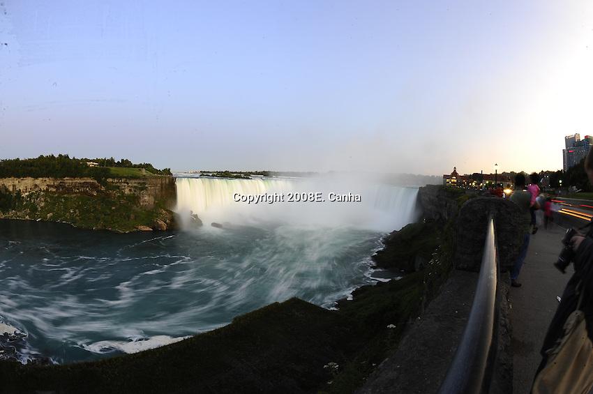 The Horseshoe Falls portion of Niagara falls and swift moving Niagara river.