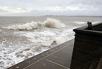 WEATHER PICTURE SWANSEA<br /> Pictured: Waves crashing against the Swansea seafront wall, south Wales. Monday 03 February 2014<br /> Re: High tides combined with strong winds are affecting parts of the UK.