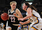 SIOUX FALLS, SD - MARCH 7:  Mikaela Shaw #22 from Omaha drives against Ellie Thompson #45 from South Dakota State University during their semifinal game of the 2016 Summit League Championship Monday afternoon in Sioux Falls. (Photo by Dick Carlson/Inertia)