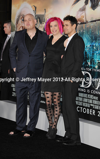 HOLLYWOOD, CA - OCTOBER 24: Andy Wachowski, Lana Wachowski and Tom Tykwer arrive at the Los Angeles premiere of 'Cloud Atlas' at Grauman's Chinese Theatre on October 24, 2012 in Hollywood, California.
