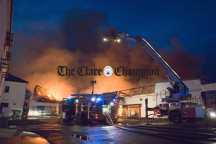 The scene at Station Road, Ennis early on Wednesday morning as fire services battle to extinguish a raging fire at Gerry Bredin's Hardware Shop. Photograph by John Kelly.