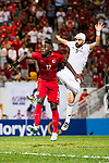 Ibrahim Zawahreh of Jordan (R) fights for the ball with Alexander Oluwatayo Akande of Hong Kong (L) during the International Friendly match between Hong Kong and Jordan at Mongkok Stadium on June 7, 2017 in Hong Kong, China. Photo by Marcio Rodrigo Machado / Power Sport Images