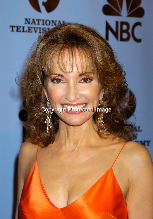 Susan Lucci ..at the Daytime Emmy Awards on May 21, 2004 in the Press Room at Radio City Music Hall...Photo by Robin Platzer, Twin Images