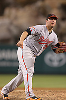 Baltimore Orioles pitcher Tommy Hunter #39 pitches against the Los Angeles Angels at Angel Stadium on August 20, 2011 in Anaheim,California. Los Angeles defeated Baltimore 9-8.(Larry Goren/Four Seam Images)