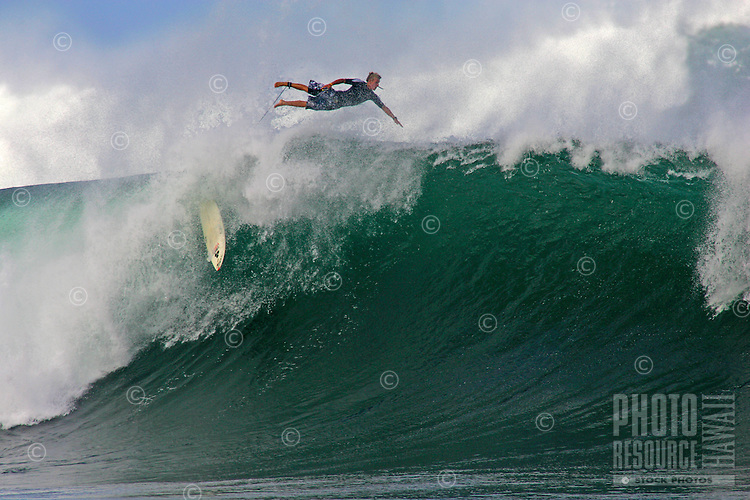 Surfer decides to bail after this wave at Pipeline closes out.