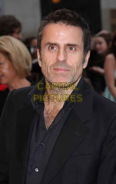 CON O'NEILL.'The Kid' UK premiere held at the Odeon West End, Leicester Square, London, England..15th September 2010.headshot black portrait shirt hairy chest .CAP/ROS.©Steve Ross/Capital Pictures
