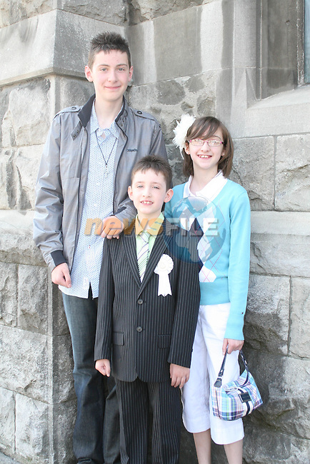 Ciaran, Conor and Amy Smith at the St. Marys Congress Avenue Communion in St. Marys Church...Photo NEWSFILE/Jenny Matthews.(Photo credit should read Jenny Matthews/NEWSFILE)....This Picture has been sent you under the condtions enclosed by:.Newsfile Ltd..The Studio,.Millmount Abbey,.Drogheda,.Co Meath..Ireland..Tel: +353(0)41-9871240.Fax: +353(0)41-9871260.GSM: +353(0)86-2500958.email: pictures@newsfile.ie.www.newsfile.ie.FTP: 193.120.102.198.