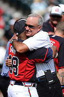 Atlanta Braves General Manager John Hart embraces former Atlanta star Ralph Garr before a Spring Training game against the New York Yankees on Wednesday, March 18, 2015, at Champion Stadium at the ESPN Wide World of Sports Complex in Lake Buena Vista, Florida. The Yankees won, 12-5. (Tom Priddy/Four Seam Images)