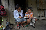 Teacher Lodema Dela Cruz Doroteo helps a woman learn to read and write in Santa Ines, an indigenous village in the Philippines. A graduate of Harris Memorial College, where she benefited from a scholarship from United Methodist Women, she is the first indigenous school teacher in her village.