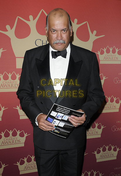 John Pienaar.At the Charity Awards 2011, Grosvenor House Hotel, Park Lane, London, England, UK, June 9th 2011..half length black black bow tie tuxedo tux .CAP/CAN.©Can Nguyen/Capital Pictures.