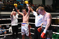 Billy Jackson (white/red shorts) defeats MJ Hall during a Boxing Show at York Hall on 8th June 2019