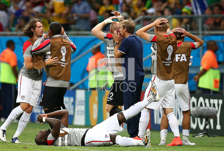 USA coach Juergen Klinsmann and his substitutes react after a missed chance late in normal time